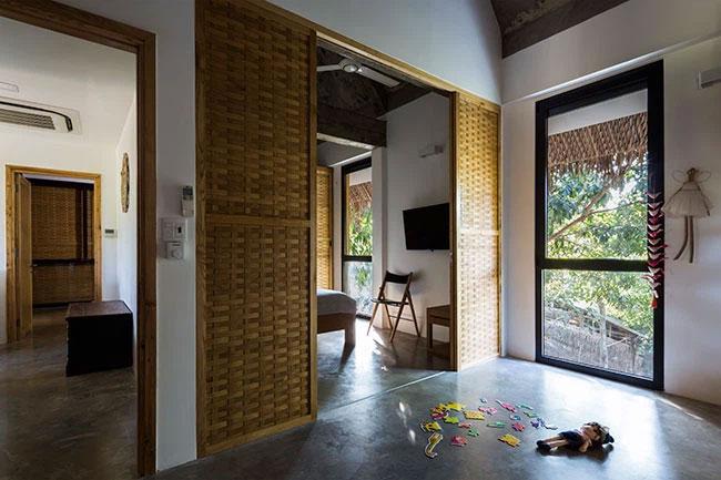 Chất liệu sàn xi măng đánh, trần bê tông, nội thất gỗ mộc với tông màu trung tính ở không gian tầng 2.